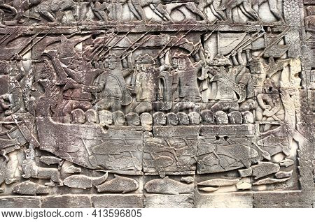 Bas-relief on stone wall of Prasat Bayon temple. Carvings scene with people in boats and fish, Angkor Wat (Angkor Thom), Siem reap, Cambodia, Indochina. UNESCO world heritage Site