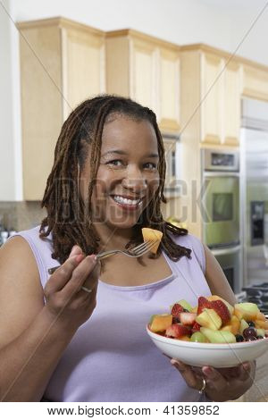 Portrait of an African American obese woman having fresh fruit salad