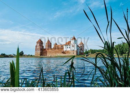 Mir Castle Complex In A Summer Day With Blue Cloudy Sky. Tourism Landmark In Belarus, Cultural Monum