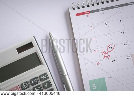 Tax Day, Red Colored Handwritten Words On May 17 Calendar. Top View. Reminder On New Tax Filing Due