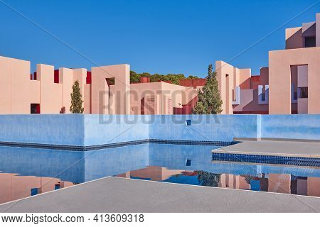 Geometric Building With Pool. The Red Wall, Calp, Spain