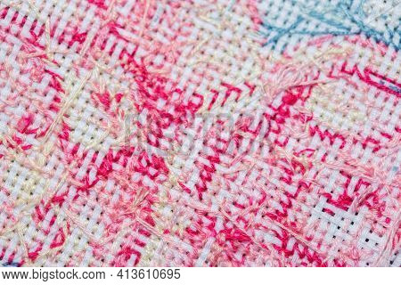 Close-up Of The Wrong Side Of A Cross-stitched Section Of The Canvas With A Pattern, Not A Perfect W