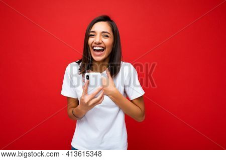 Photo Of Attractive Crazy Amazed Surprised Young Woman Wearing Casual Stylish Clothes Standing Isola