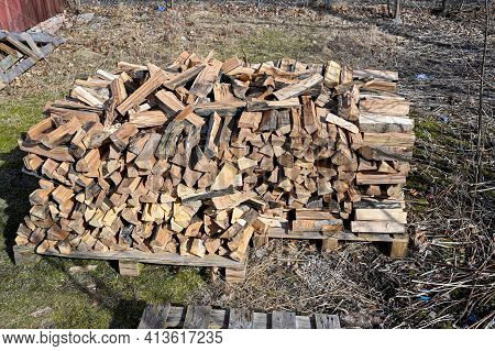 Firewood Piled Outside To Dry In Spring