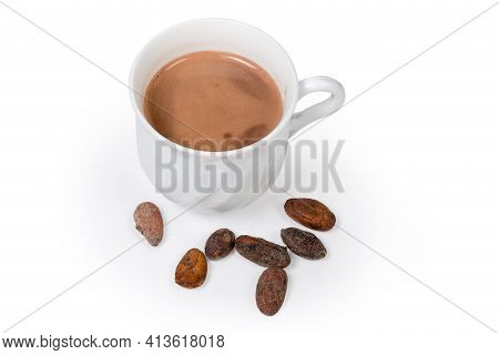 Several Dried Cocoa Beans And Cup Of Hot Cocoa On A White Background