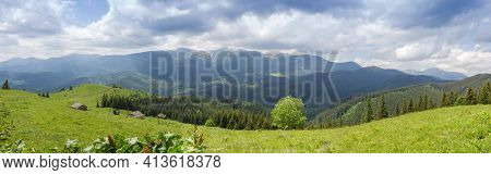 Distant Mountain Range Against Cloudy Sky, Pastures On Alpine Meadows On A Foreground In The Carpath