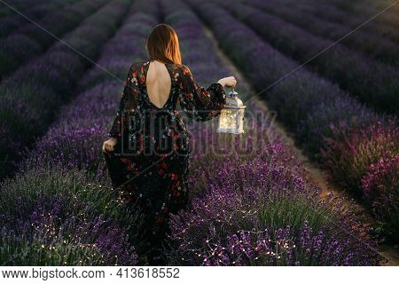 Romantic Woman In Lavender Fields, Having Vacations. Woman Walking In Lavender Fields At Sunset.a Yo