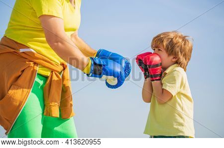 Father Is Training His Son Boxing. Little Boy Sportsman At Boxing Training With Coach. Sports Man Co