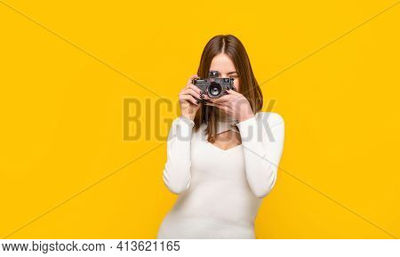 Woman Holding Camera Over Yellow Background. Girl Using A Camera Photo. Photographer Camera Photo, P