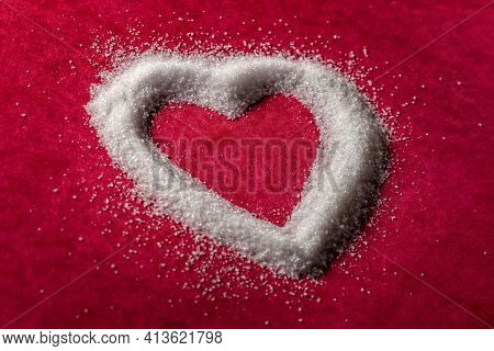 Sugar grain sweet heart shape concept for sweetheart, romance or unhealthy eating and diabetes