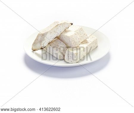 Cube Of Taro Root Isolated On A White Background.