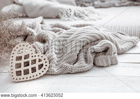 Still Life In Hygge Style With A Decorative Heart And A Knitted Element On A Wooden Surface. The Con