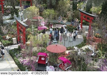 Singapore - Mar 19, 2021: People Walk In The Gardens By The Bay Flower Dome Pavillion In Singapore.