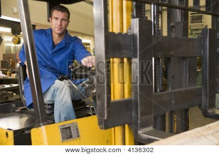 Warehouse worker in forklift poster