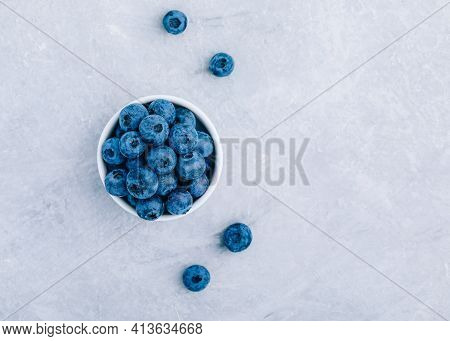 Blueberry. Fresh Ripe Organic Blueberries In Bowl On Gray Stone Background, Top View, Copy Space