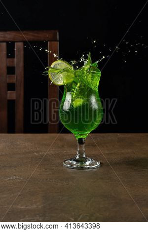 Splash Of Green Tarragon Lemonade In A Glass Decorated With A Sprig Of Fresh Tarragon And A Slice Of