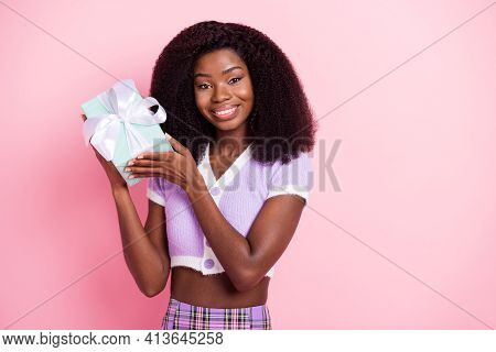 Portrait Of Charming Cheerful Wavy-haired Girl Holding In Hands Giftbox Greetings Isolated Over Pink