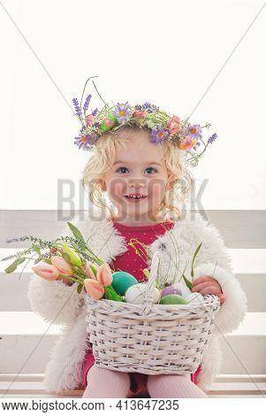 happy spring easter egg hunt girl with flower basket