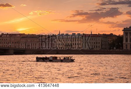 Small Tourist Boat With Tourists Is On A Boat Trip On Neva River At White Night In Saint-petersburg,