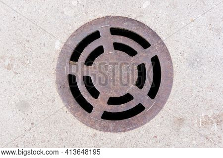 Round Manhole On Concrete Drain System Cover. Urban Sewer Background. Metal Drain Cover Texture. Emp