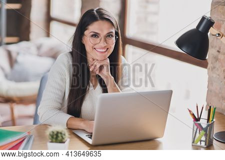 Photo Of Successful Lady Sit Table Work Netbook Look Camera Arm Chin Wear Specs White Sweater In Liv
