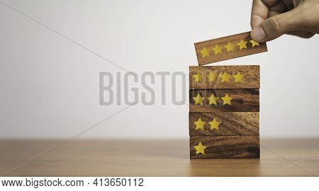 Hand Putting Five Start Which Print Screen On Wooden Cube Block, Customer Satisfaction For Product A