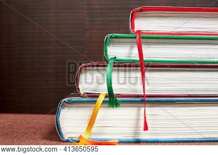 Different Colorful Books On The Bookshelf In The Library. Bookshop And Literature Backgrounds