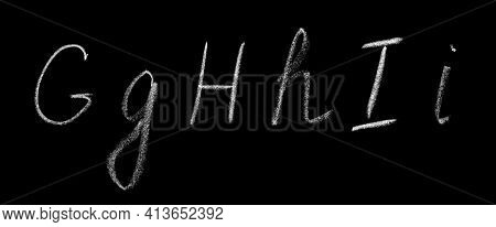 Uppercase And Lowercase Letters G, H, I Of The English Alphabet Written By Hand In Chalk On A Blackb