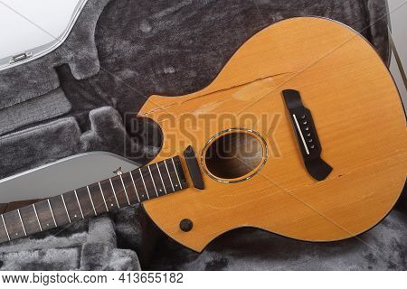 Musical Instrument - Front View Closeup Fragment Broken Acoustic Guitar In Hard Case