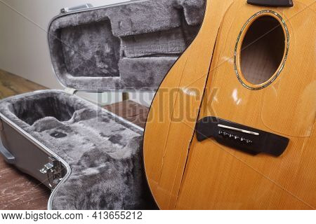 Musical Instrument - Side View Closeup Fragment Broken Acoustic Guitar In Hard Case
