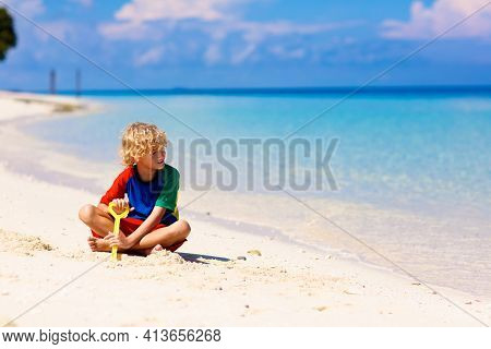 Kids Play On Tropical Beach. Sand Toys. Children Build Sand Castle. Child Playing At Sea On Summer F