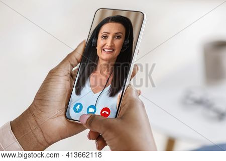 Online Tutoring. Unrecognizable Black Woman Using Smartphone For Video Call With Tutor