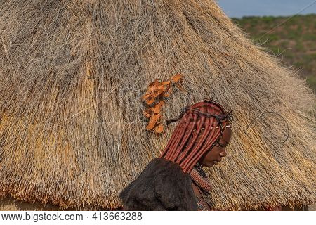Khorixas. Namibia, January 13. 2020: Side View Of A Himba Tribe Woman With Here Hair Dress In The Vi