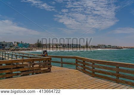 Swakopmund, Namibia - Jan 11, 2020: View From The Jetty To Swakopmund City In Summer On A Sunny Day