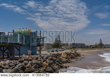 Swakopmund, Namibia - Jan 11, 2020: The Historic Jetty Of Swakopmund On A Sunny Day In Summer. Namib