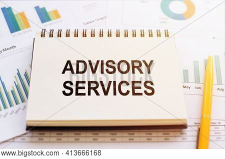 Advisory Services - Written On Notepad On Financial Charts And Graphs With Yellow Pen.