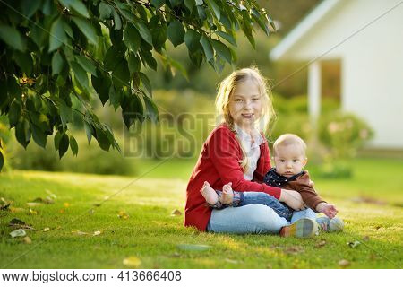 Cute Big Sister Cuddling With Her Baby Brother. Adorable Teenage Girl Holding Her New Baby Boy Broth