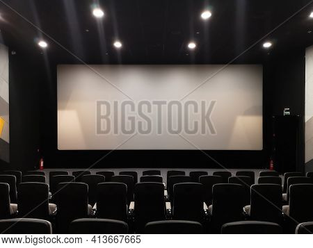 Cinema Screen And Empty Chairs. Absence Of Visitors During The Coronavirus Pandemic