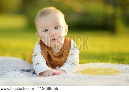 Cute Five Months Old Baby Boy Lying On His Tummy On A Blanket In A Park On Sunny Summer Day. Infant