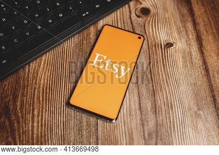 Etsy Logotype On Phone With Keyboard, Wooden Desk