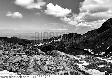 Glacial Lake And Rocky Peaks In The Tatra Mountains In Poland ,monochrome