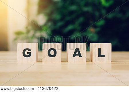 Word Goal Block Wood On Wooden Table Background. Goal Business Concept.