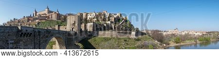A Panorama View Of The Historic Spanish City Of Toledo On The Tagus River With The Roman Bridge In T