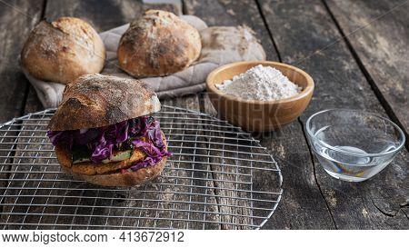 Delicious Vegan Burger Full Of Vegetables Made With Home Made Sourdough Bread Bun.