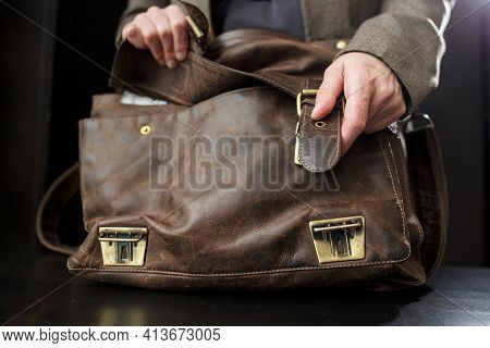 Hands Professor Open Buckle On The Old Leather Briefcase, Before Class. Education Concept.