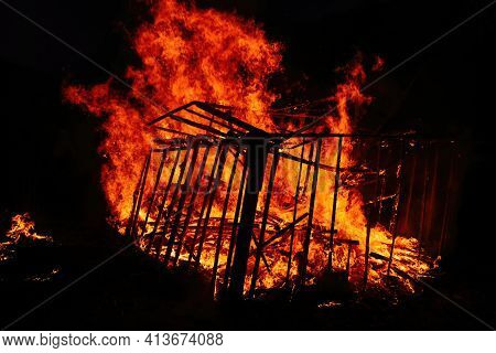 Burning Wooden Building At Night, Close Up View