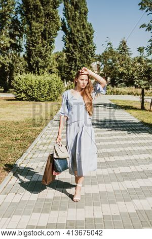 Summer Sale, Summer Shopping, Consumerism, Shopaholic, Lifestyle. Young Blonde Happy Woman With Shop