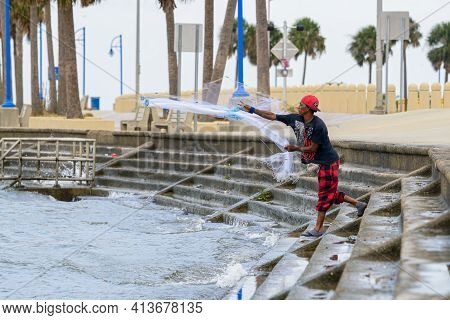New Orleans, La - October 9: Man Casts Net For Bait On Lake Pontchartrain On October 9, 2020 In New