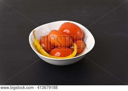Pickled Red Tomatoes With Chilli In A Plate.