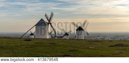 The Historic Whitewashed Spanish Windmills Of La Mancha Above The Town Of Campo De Criptana In Warm